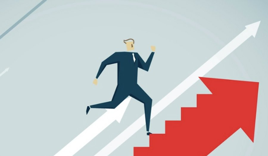 Businessman running up steps on a red arrow