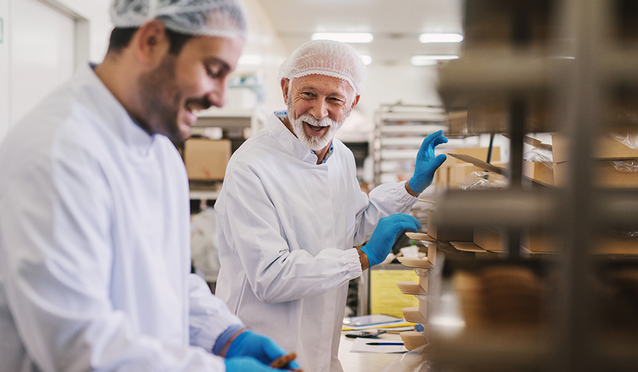 Picture of two male research chefs in sterile clothes developing new product