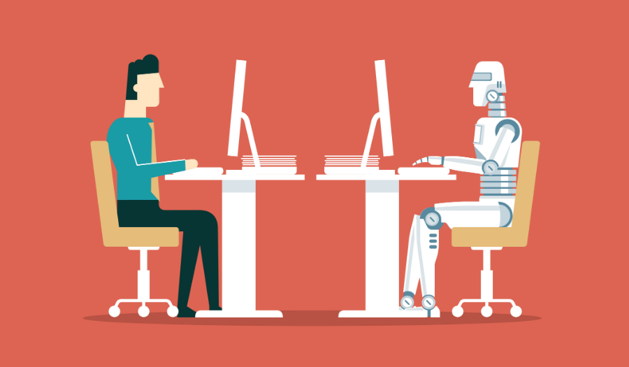 man and robot sitting at computers across from each other