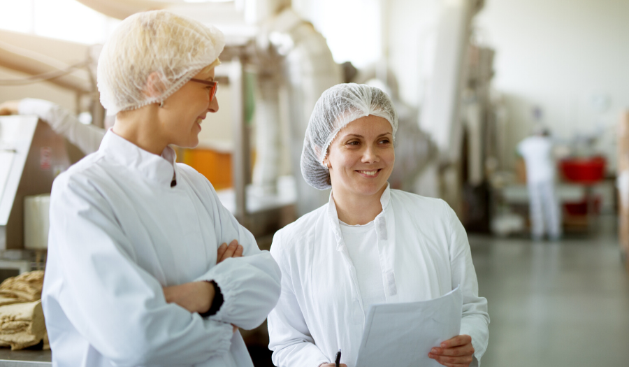 quality professionals in food plant during an audit walk through